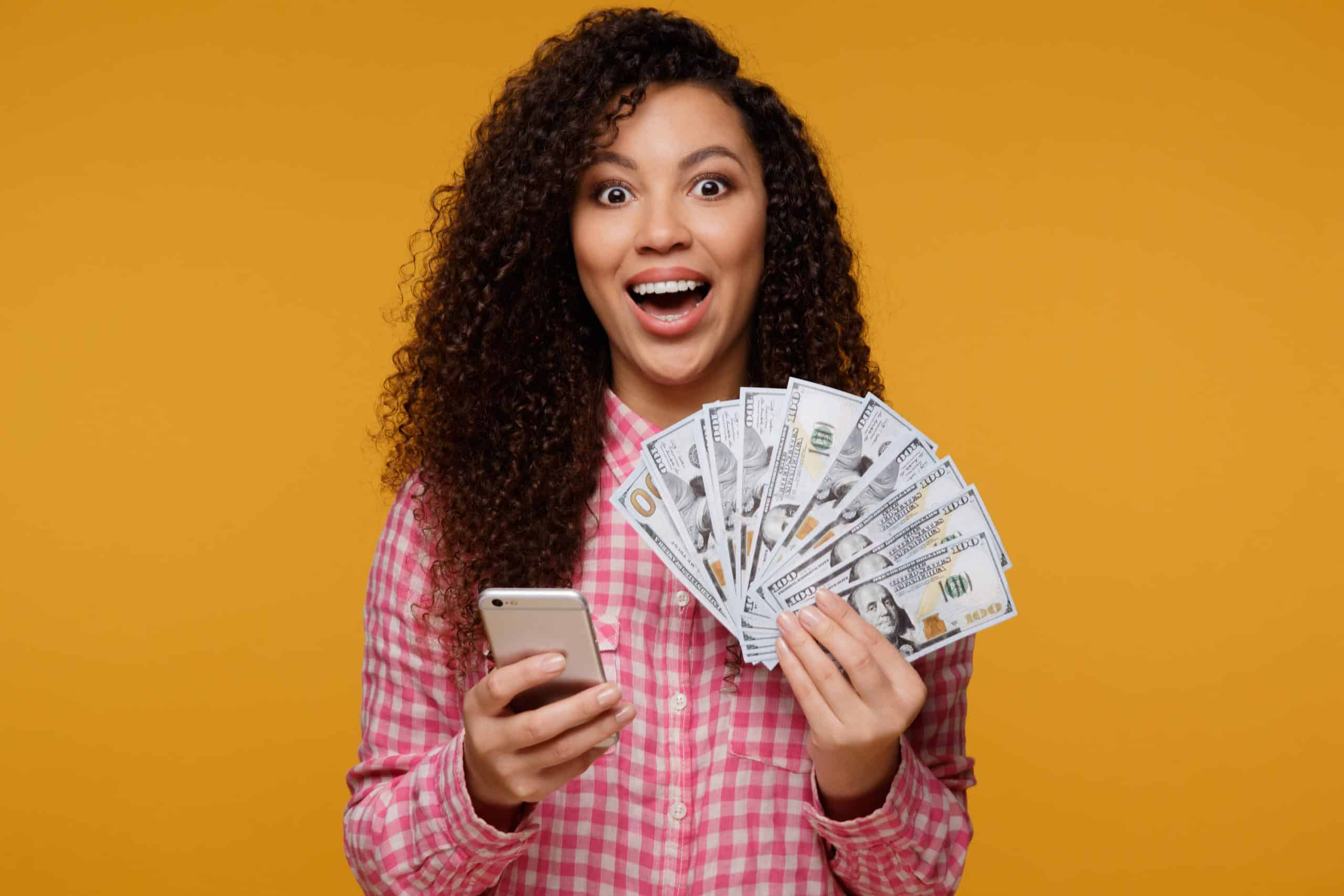 young-girl-holding-cash-in-pink-shirt-credit-score