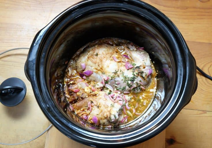 Pulled pork cooking in crockpot or slow cooker