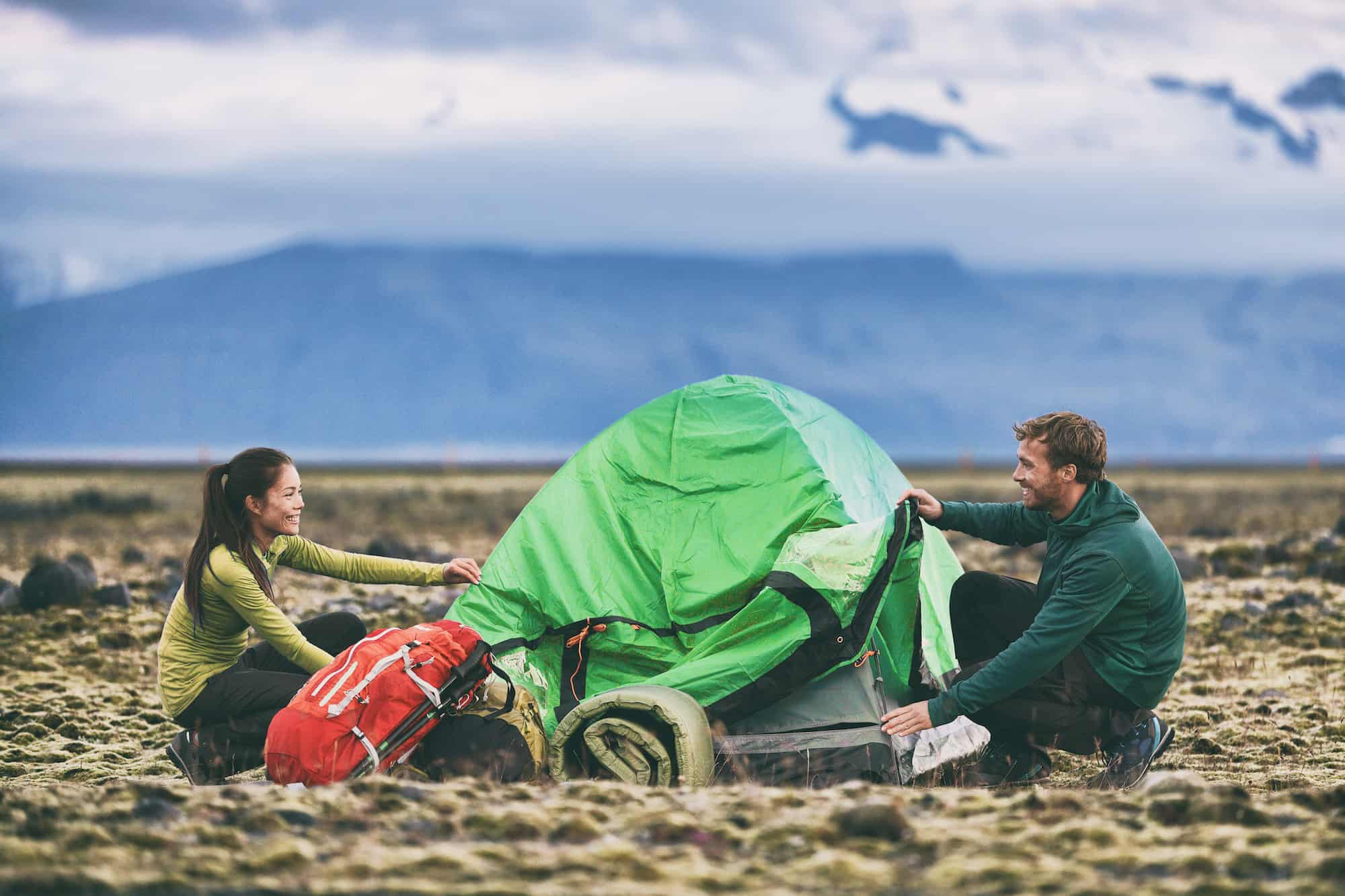 outdoor gear companies couple with tent