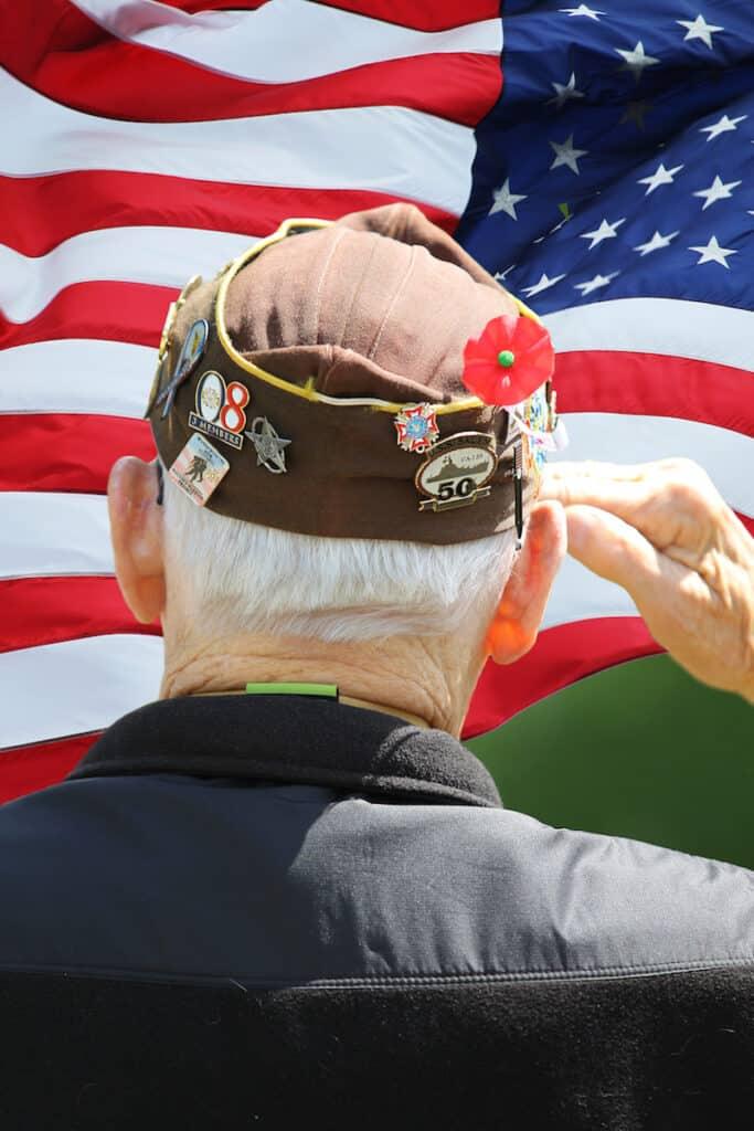 Veteran saluting the flag.