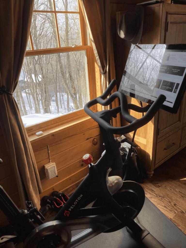 Peloton bike in front of a window.